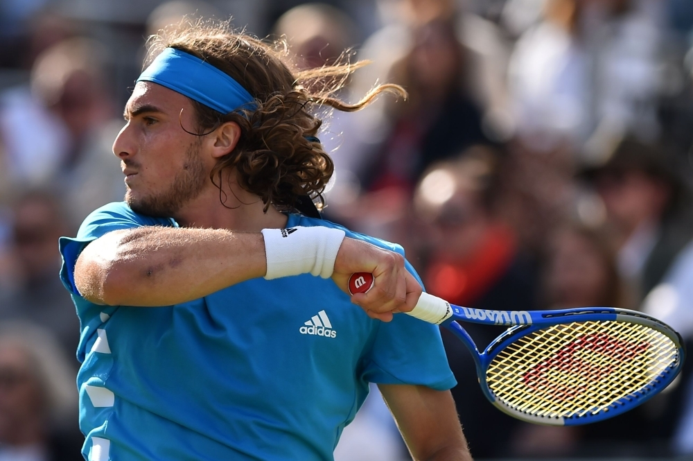 Greece's Stefanos Tsitsipas returns to France's Jereme Chardy during a second round match at the ATP Fever-Tree Championships tennis tournament at Queen's Club in west London on Thursday. — AFP