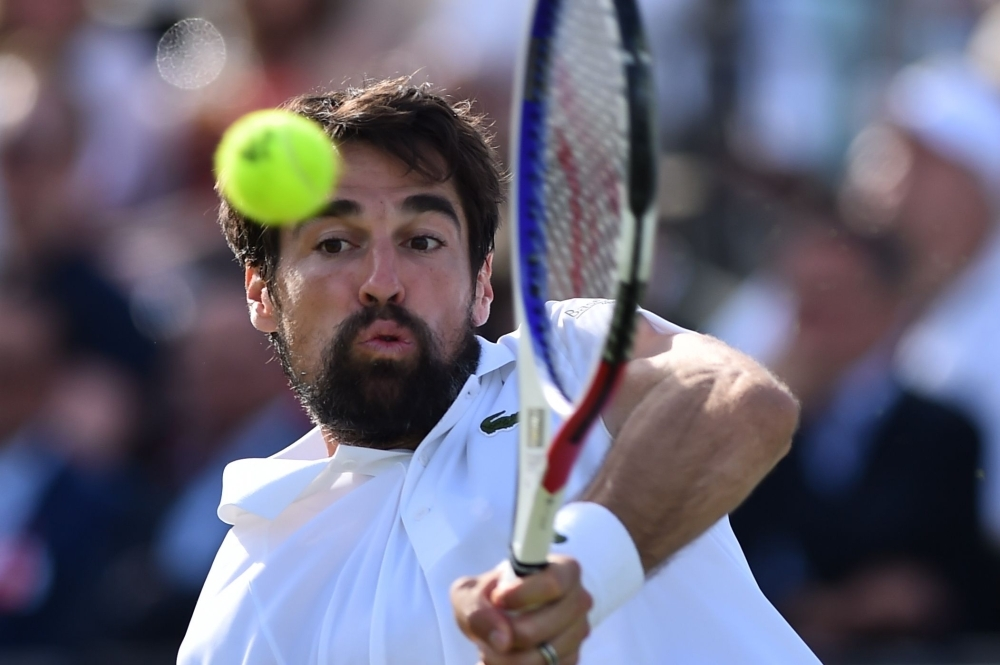 France's Jeremy Chardy returns to Greece's Stefanos Tsitsipas during a second round match at the ATP Fever-Tree Championships tennis tournament at Queen's Club in west London on Thursday. — AFP