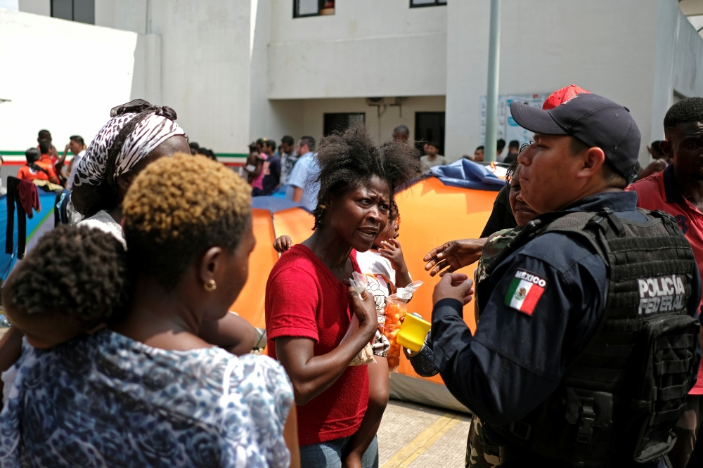 Women from Africa and Haiti argue with a policeman during a protest at the premises of the National Migration Institute (INM), in Tapachula, Mexico, in this April 9, 2019 file photo. — Reuters