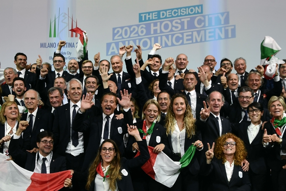 Members of the Italian delegation for 2026 Winter Olympics candidate city react after Milan was elected to host the Winter Olympic Games