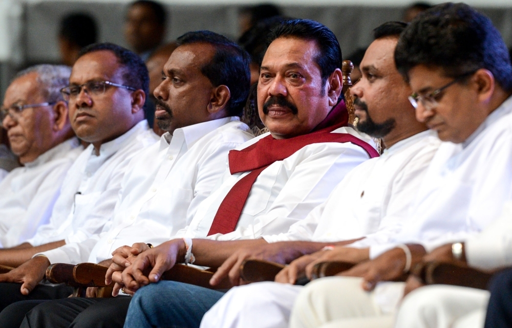 Sri Lankan former President Mahinda Rajapaksa, center, looks on during a remembrance ceremony in Colombo on June 21, 2019, two months ago after Easter Sunday bombings targeting churches and luxury hotels that killed 258 people. — AFP