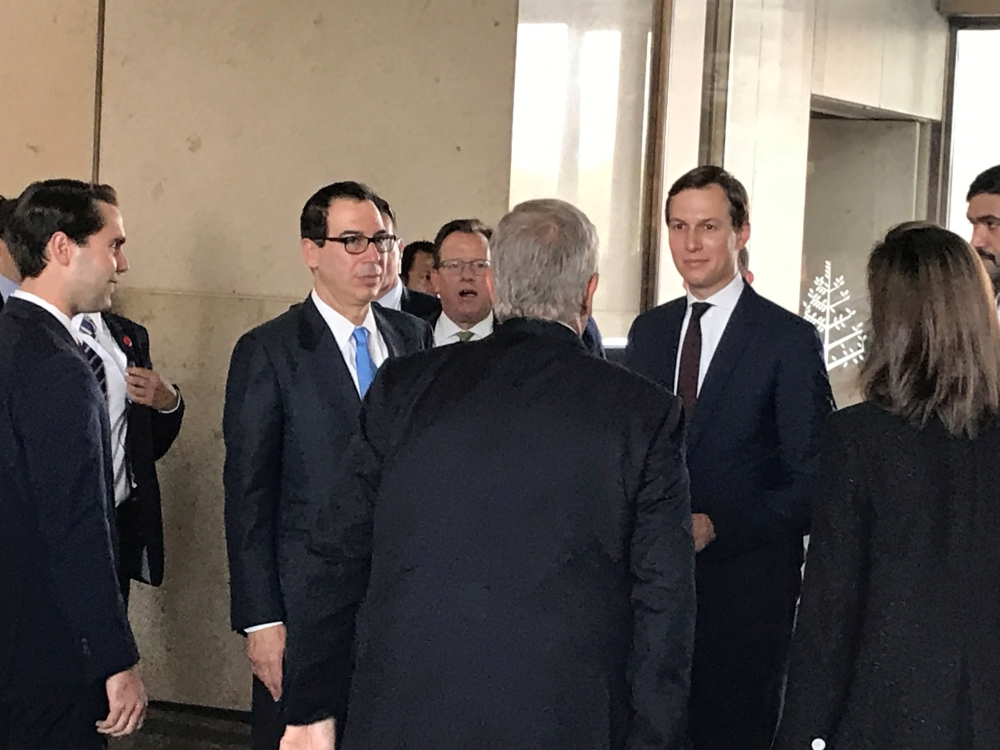 White House senior adviser Jared Kushner and Treasury Secretary Steven Mnuchin arrive at Manama's Four Seasons hotel, the venue for the US-hosted