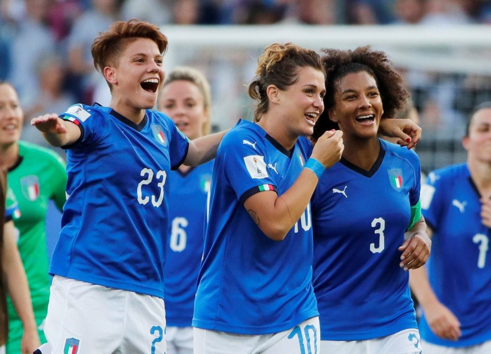 Italy's Manuela Giugliano, Cristiana Girelli and Sara Gama celebrate after the Women's World Cup  round of 16 match against China at the Stade de La Mosson, Montpellier, France on Tuessday. — Reuters