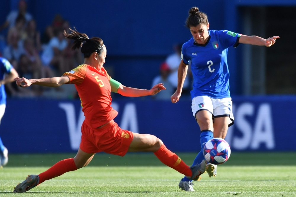 China's defender Haiyan Wu (L) vies with Italy's midfielder Valentina Bergamaschi during the France 2019 Women's World Cup round of sixteen football match at La Mosson stadium in Montpellier, south western France, on Tuesday. — AFP