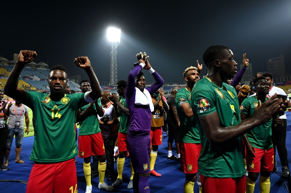 Cameroon's players celebrate their win with the fans during the 2019 Africa Cup of Nations (CAN) football match against Guinea-Bissau at the Ismailia Stadium on Tuesday. — AFP