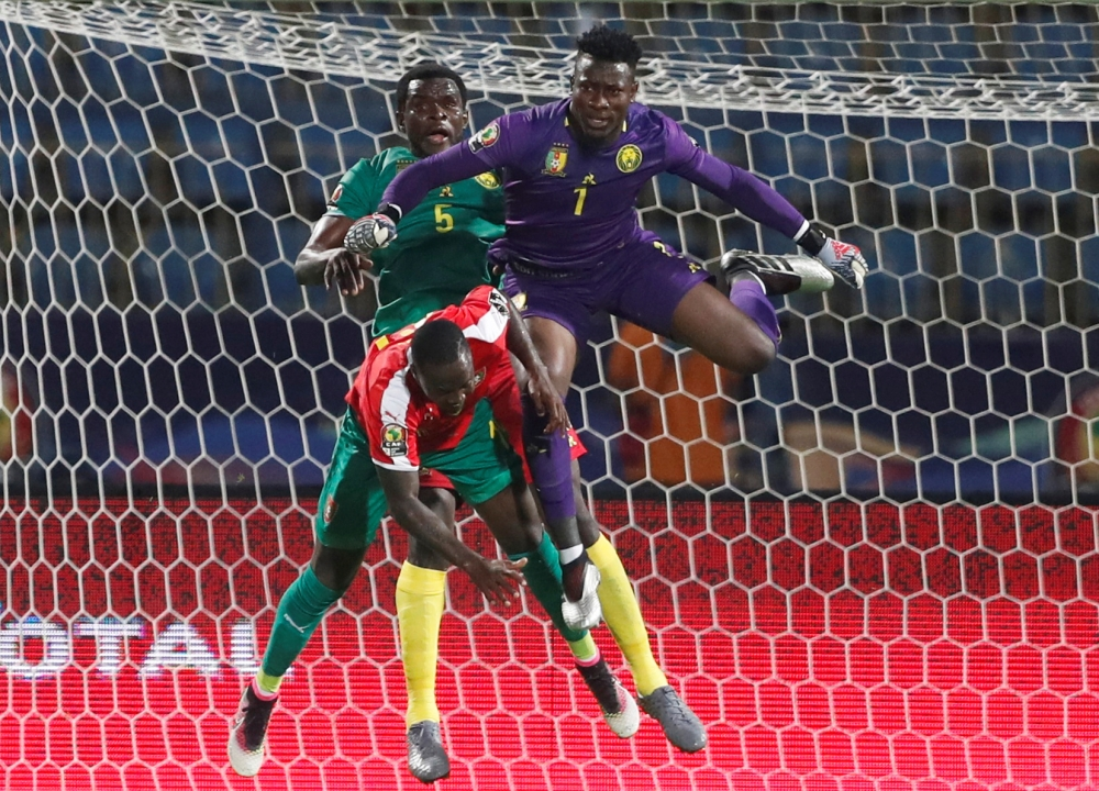 Cameroon's Andre Onana and Michael Ngadeu in action with Guinea-Bissau's Juary Soares during the 2019 Africa Cup of Nations (CAN) football match at the Ismailia Stadium on Tuesday. — AFP
