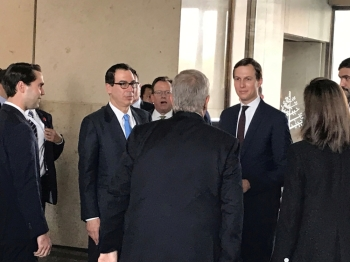 White House senior adviser Jared Kushner and Treasury Secretary Steven Mnuchin arrive at Manama's Four Seasons hotel, the venue for the US-hosted