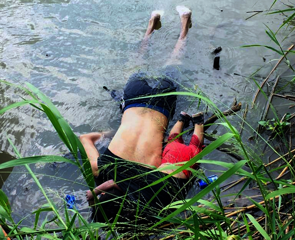 View of the bodies of Salvadoran migrant Oscar Martinez Ramirez and his daughter, who drowned while trying to cross the Rio Grande in Matamoros, state of Coahuila on Monday. -AFP