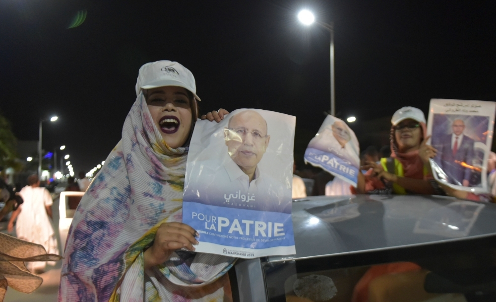 People celebrate the presidential election victory by Mauritania's ruling party candidate Mohamed Ould Ghazouani in Nouakchoot on June 23. -AFP