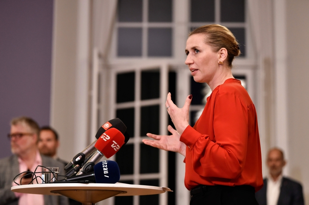 Denmark's Social Democrat leader Mette Frederiksen talks to the press after finalizing the government negotiations at Christiansborg Castle in Copenhagen, Denmark, Tuesday. -AFP
