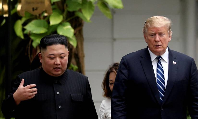North Korea's leader Kim Jong Un and US President Donald Trump talk in the garden of the Metropole hotel during the second North Korea-US summit in Hanoi, Vietnam February 28, 2019. -Courtesy photo