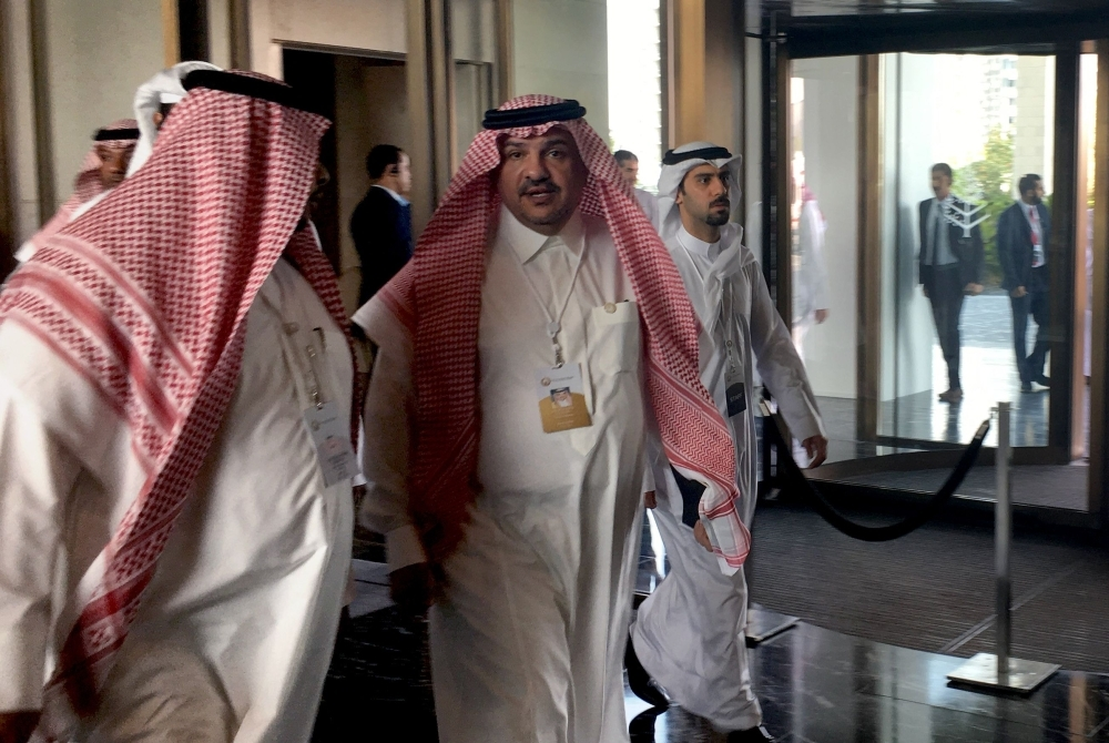 Saudi Minister of State Mohammed Al-Shaikh (C) arrives for the second day of a US-sponsored Middle East economic conference  in Manama on Wednesday. — AFP