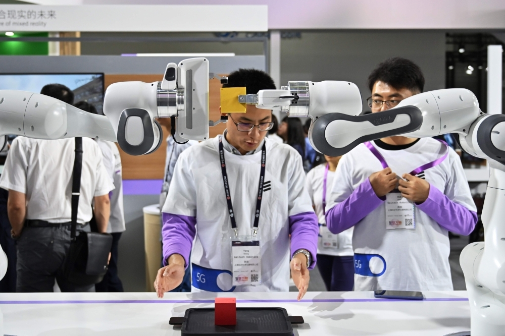 Robots are seen in the Ericsson stand during the Mobile World Congress (MWC 2019) introducing next-generation technology at the Shanghai New International Expo Centre (SNIEC) in Shanghai on Wednesday. — AFP