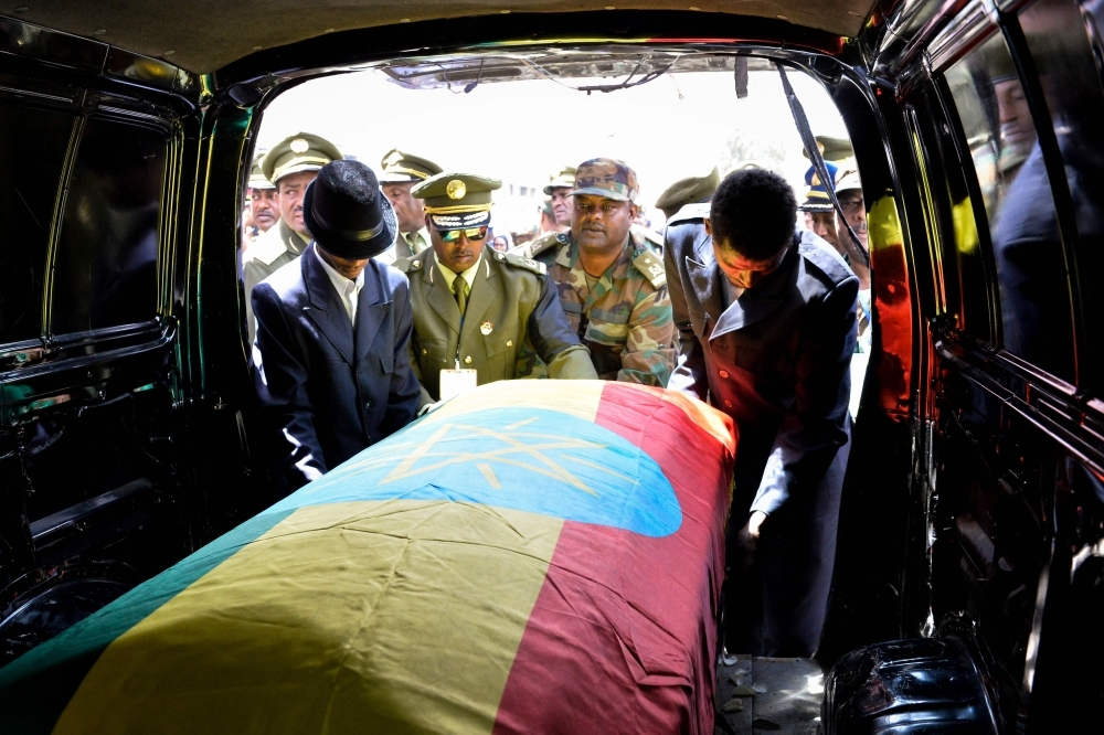 Members of the army carry one of the coffins covered with the Ethiopian national flag as they arrive at the millennium hole in Addis Ababa on Tuesday for the national funeral service of Chief of Staff of the Ethiopian defense forces Seare Mekonnen and of Major-General Geza'e Abera, a retired former senior official in the Ethiopian army. — AFP