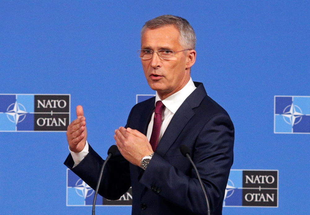 NATO Secretary-General Jens Stoltenberg speaks during a news conference after a NATO Defense Ministers meeting in Brussels, Belgium, on Wednesday. — Reuters