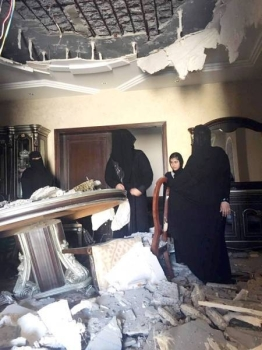 Members of the Al-Jahdali family inspect the damage after the roof of their villa in Al-Hamdaniyyah district of Jeddah collapsed on Tuesday morning.