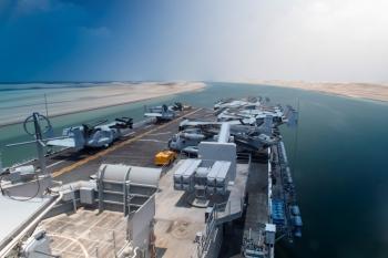 The Wasp-class amphibious assault ship USS Kearsarge (LHD 3) passes under the Mubarak Peace Bridge while transiting the Suez Canal, Egypt, on Sunday. — Reuters