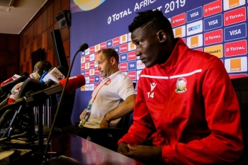 Kenya's coach Sebastian Migne (C) and Kenya's forward Michael Olunga (R) attend a press conference at the 30 June Stadium in Cairo on Wednesday, on the eve of the 2019 Africa Cup of Nations (CAN) football match between Kenya and Tanzania. — AFP