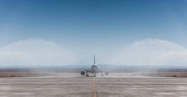 Saudia flight SV2030 lands at Neom Bay airport on Sunday.