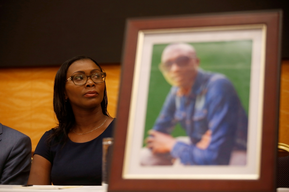 Esther Kabau-Wanyoike the sister of Kenyan George Kabau who died in the Ethiopian Airlines crash sit next to his picture during a news conference where her lawyers announced they plan to file a wrongful-death lawsuit against Boeing, at the Serene hotel in Nairobi, Kenya, in this April 16, 2019 file photo. — Reuters