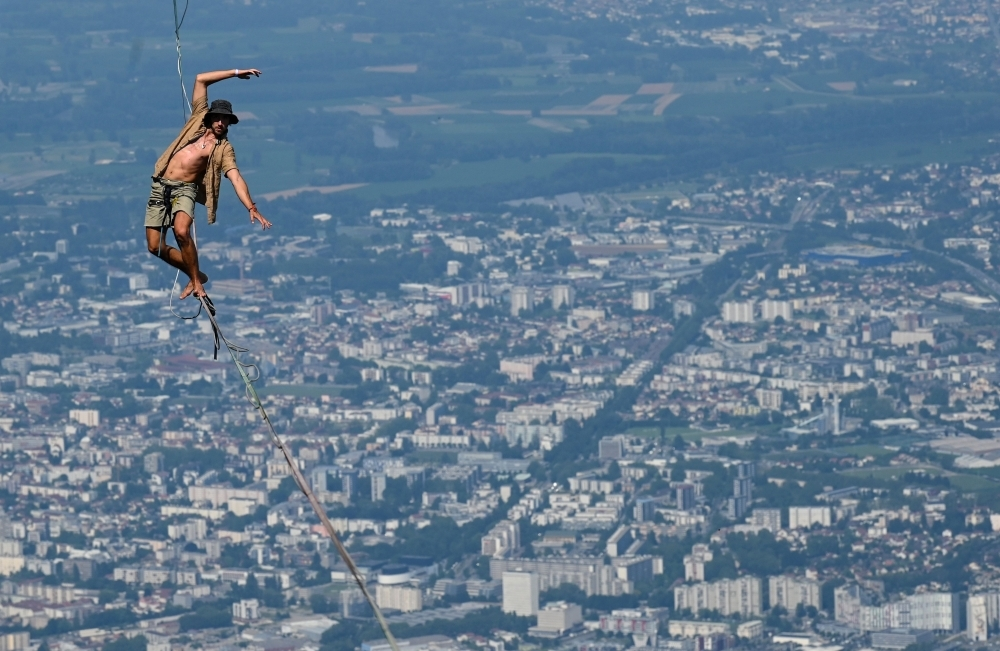 A man walks on a slackline during the 7th edition of the European 'Marmotte Highline Project' (MHP) festival in Lans-en-Vercors, near Grenoble, eastern France, on Thursday. The event, during which the participants will be able to evolve on the various high lines located in the Regional Natural Park of Vercors, takes place until July 7, 2019. — AFP