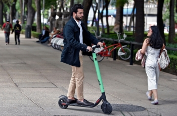 A man rides a rented electric scooter at Juarez neighborhood in Mexico City in this July 2, 2019 file photo. — AFP