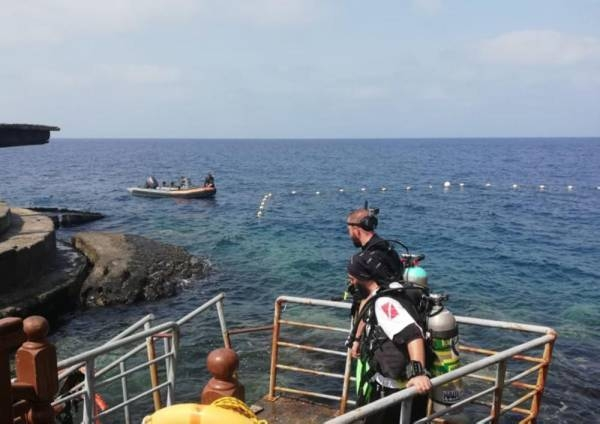 Border Guard rescue teams recover the body of Bassam Bakheet from the North Obhur sea.