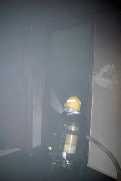 Firefighters enter the burning apartment in Al-Faisaliyyah district of Riyadh.