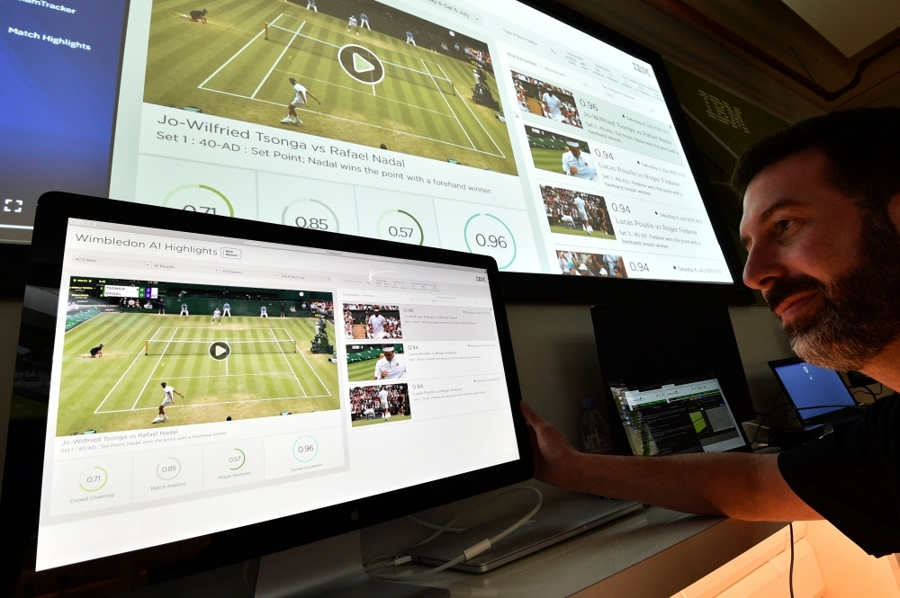 An IBM technician poses with screens showing IBM's AI-generated highlights of play on the sixth day of the 2019 Wimbledon Championships at The All England Lawn Tennis Club in Wimbledon, southwest London, in this July 6, 2019 file photo. — AFP
