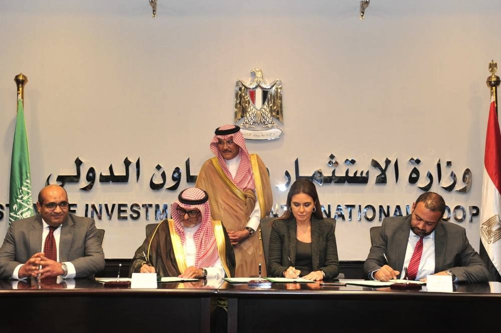 Saudi and Egyptian officials sign the aid agreements in Cairo.