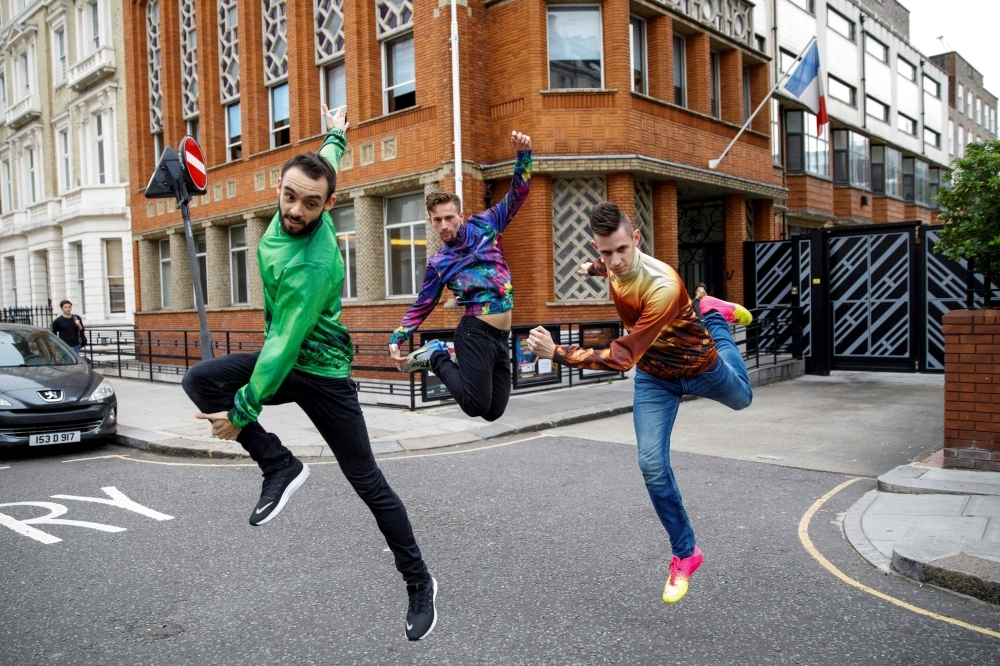 Members of French dance collective La Horde, left, Kevin Martinelli, center, Mathieu Douay and Edgar Scassa perform at the Institut Francais in London on July 10, 2019 during a photo-call to promote the launch of FranceDance UK.  FranceDance UK, a four-month festival is set to bring French contemporary dance to venues across the country, starting at the Edinburgh International Festival on Aug. 8, 2019. — AFP