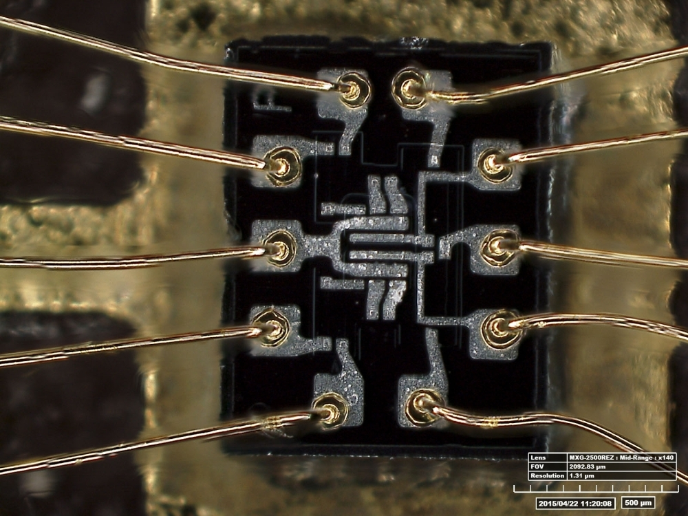 This undated handout photo released by the Smithsonian National Air and Space Museum on Thursday shows a microscopic view of dual, three-element NOR gate, the inside of a silicon chip, used in Apollo. — AFP