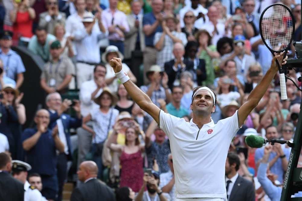 Switzerland's Roger Federer celebrates beating Spain's Rafael Nadal during their men's singles semi-final match on day 11 of the 2019 Wimbledon Championships at The All England Lawn Tennis Club in Wimbledon, southwest London, on Friday. — AFP