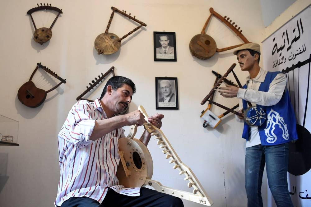 Egyptian craftsman Mohamed Ghaly adds the finishing touches on a semsemia fan that he made at the Canal 20 cultural museum in the northeastern city of Port Said at the northern terminus of the Suez Canal. The semsemia, a triangular lyre-lookalike instrument with a circle at the bottom and made of beech wood with steel strings, is believed to have ancient Egyptian roots, appearing on ornate engravings on tombs. — AFP