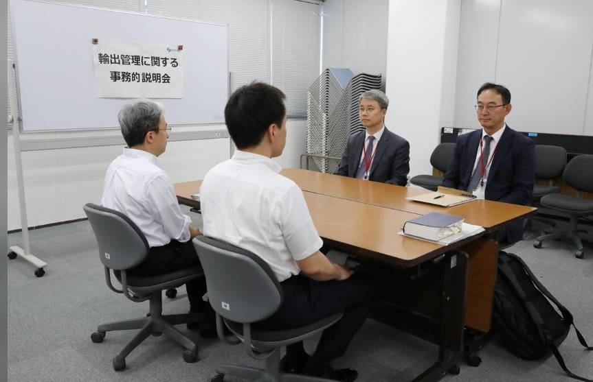 Working level officials from Japan (L) and South Korea hold a meeting about Japan's recent restrictions on exports of high-tech material to South Korea in Tokyo, Japan, July 12, 2019. — Reuters