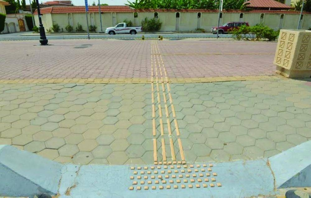 Using white sticks, the blind can easily use these tracks to reach their destinations in the holy city. — Courtesy photo