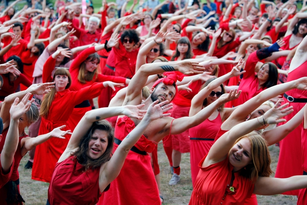 Fans of English singer Kate Bush perform a dance during a flash mob event to mark