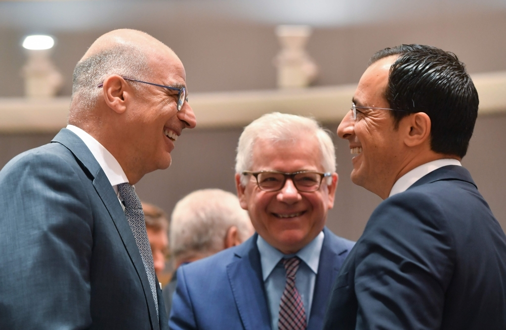 Greek Foreign Minister Nikolaos Georgios Dendias, left, talks with Polish Foreign MinisterJacek Czaputowicz, center and Cyprus Foreign Minister Miro Cerar during a Foreign Affairs meeting at the EU headquarters in Brussels on Monday. — AFP