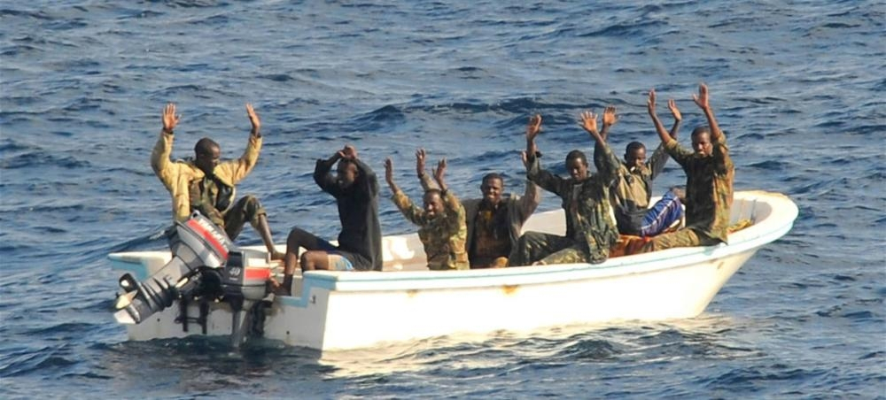 Suspected pirates wait for members of the counter-piracy operation to board their boat in this file picture. — Courtesy photo