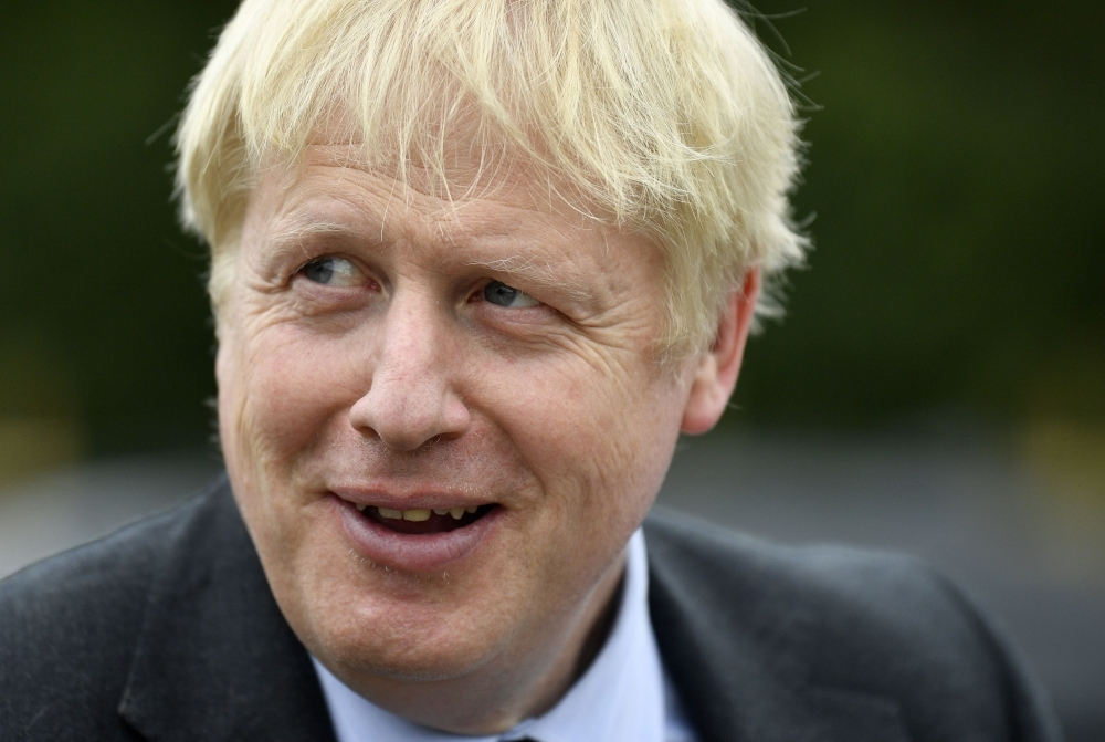 Conservative MP and leadership contender Boris Johnson gestures during a leadership campaign visit to a nursery in Braintree, southeast England, in this July 13, 2019 file photo. — AFP
