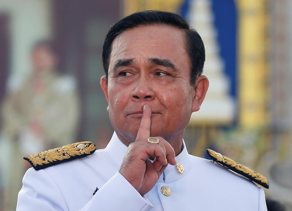 Thailand's Prime Minister Prayuth Chan-ocha reacts while taking questions from journalists after the group photo session with new government Cabinet in Bangkok, Thailand, on Tuesday. — Reuters