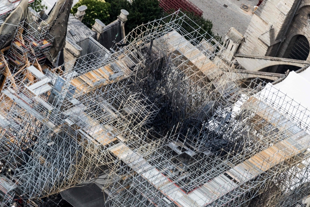 This aerial picture taken on July 14, 2019 in the French capital Paris shows the Notre-Dame de Paris cathedral under construction after it was badly damaged by a huge fire last April 15. — AFP