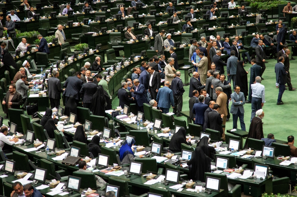 Iranian lawmakers attend a session of parliament in Tehran on Tuesday. — Reuters