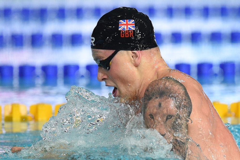In this file photo taken on Aug. 4, 2018 Britain's Adam Peaty competes in the men's 100m breaststroke swimming final at the Tollcross swimming center during the 2018 European Championships in Glasgow. Virtually untouchable when on song, breaststroke king Adam Peaty spearheads a potent British team at next week's world swimming championships in Gwangju, South Korea. — AFP