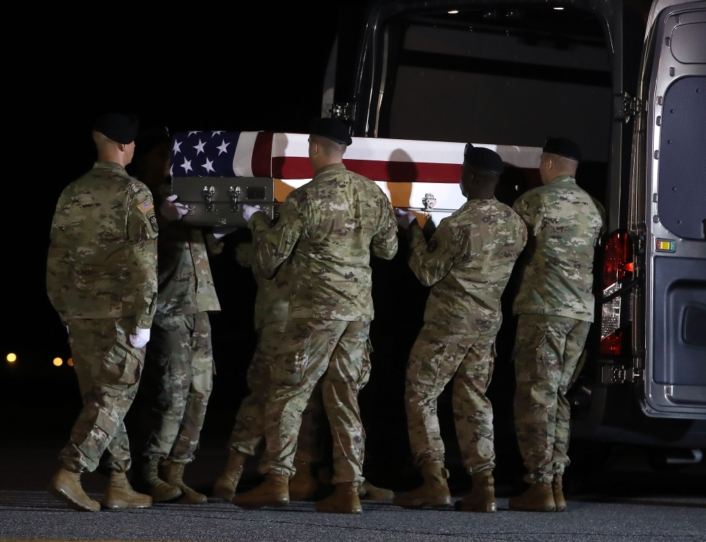A US Army carry team loads the remains of US Army Sgt. Maj. James G. Sartor into a mortuary van during a dignified transfer at Dover Air Force Base, in Dover, Delaware, in this July 15, 2019 file photo. Sgt. Maj. Sartor, 40, from Teague, Texas was a Special Forces company sergeant major, died July 13th during combat operations in Faryab province, Afghanistan. — AFP