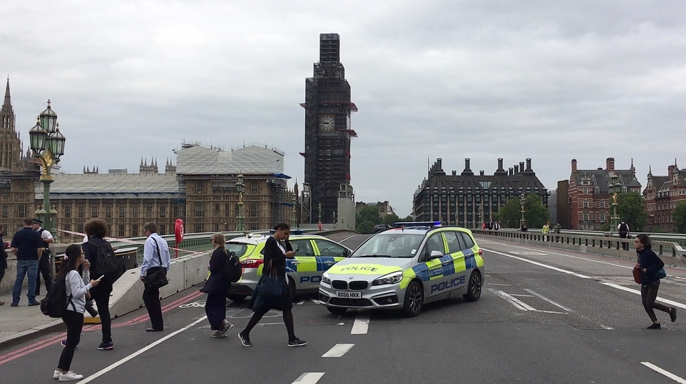 Police officers cordon off Westminster Bridge, leading to Parliament Square in central London, after a car was driven into barriers at the Houses of Parliament, in this Aug. 14, 2018 file photo. — AFP