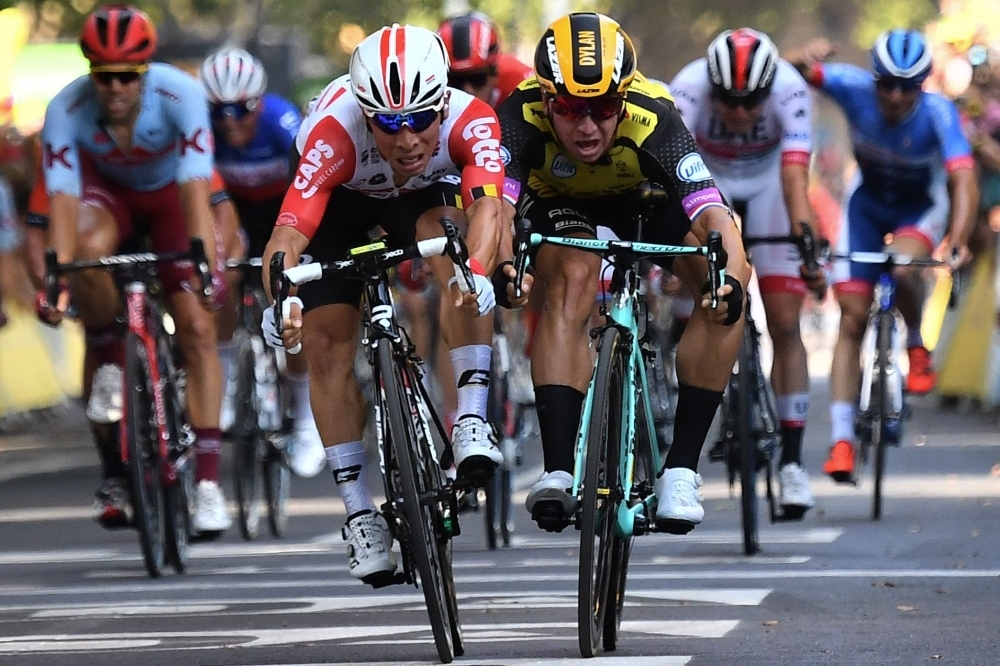 Australia's Caleb Ewan (front L), moves past Netherlands' Dylan Groenewegen to win on the finish line of the eleventh stage of the 106th edition of the Tour de France cycling race between Albi and Toulouse, in Toulouse on Wednesday. — AFP