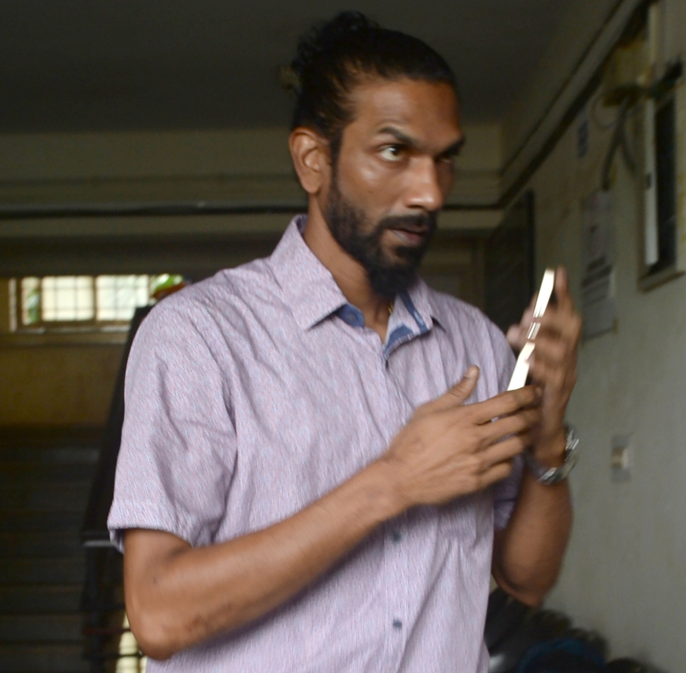 Samson D'Souza, one of two Indian defendants in the case of the rape and death of British schoolgirl Scarlett Keeling in Goa in 2008, arrives at the Children's Court in Panaji, Goa, India, in this Sept. 22, 2016 file photo.  — AFP