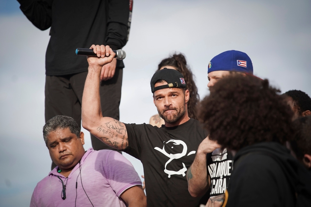 Ricky Martin gestures after speaking during a demonstration demanding Governor Ricardo Rossello's resignation in San Juan, Puerto Rico, on Wednesday. — AFP