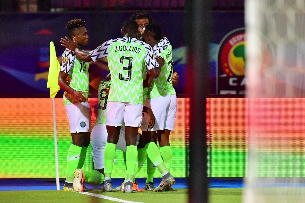 Nigeria's forward Odion Ighalo (2nd-L) celebrates with his team after scoring a goal during the 2019 Africa Cup of Nations (CAN) third place playoff football match between Tunisia and Nigeria at the Al Salam stadium in Cairo on Wednesday. — AFP